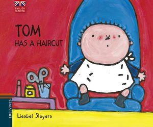 TOM HAS A HAIRCUT